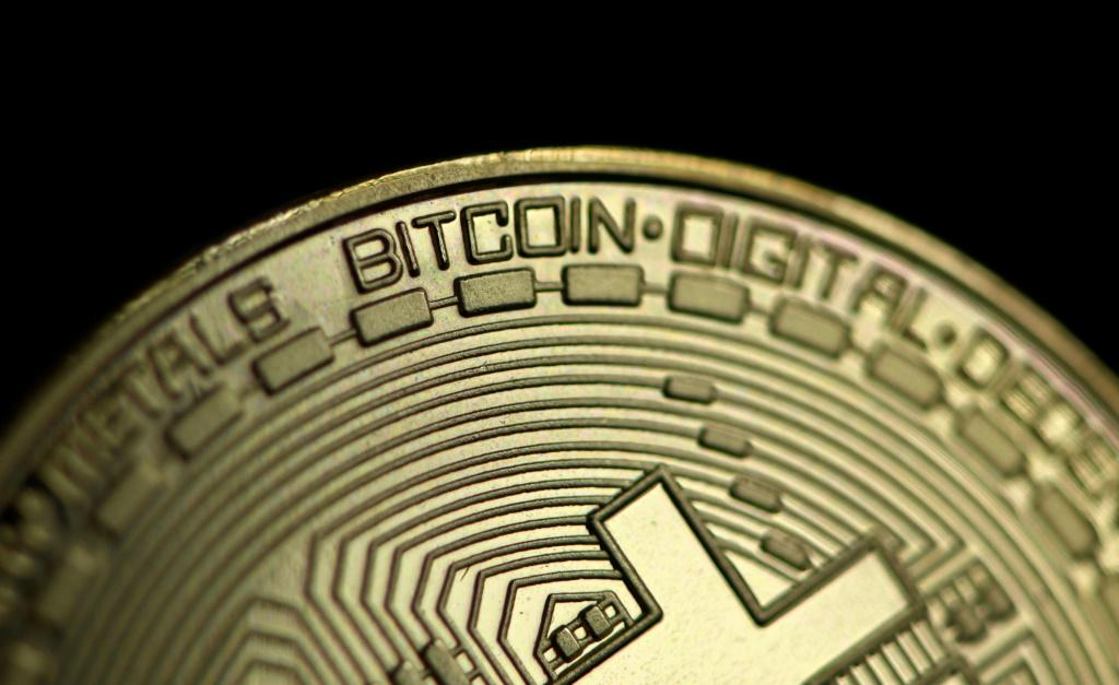 Bitcoin is sitting just short of its recent record high, ahead of the trading debut of Coinbase in New York