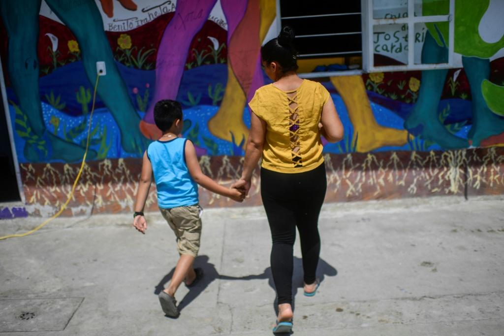Greyssi Venegas and her son Eduardo left Honduras after she lost her job on a coffee farm following hurricanes