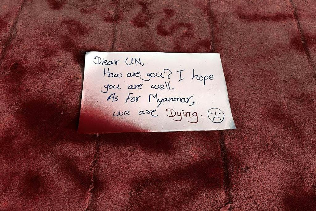 """Protesters spray-painted pavements red in a Yangon suburb and left a note that read: """"Dear UN, How are you. I hope you are well. As for Myanmar, we are dying."""