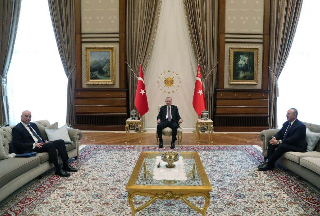 Turkish President Recep Tayyip Erdogan, seated at centre, receives Greek Foreign Minister Nikos Dendias, at left, at the presidential complex in Ankara
