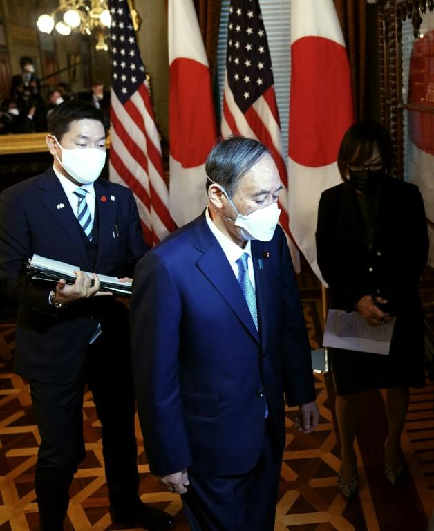Japanese Prime Minister Yoshihide Suga arrives for a meeting with US Vice President Kamala Harris