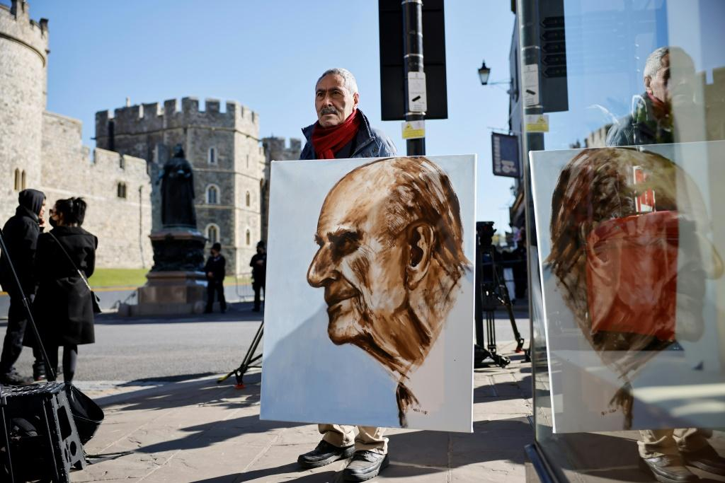Artist Kaya Mar holding a portrait of Prince Philip ahead of the funeral Saturday