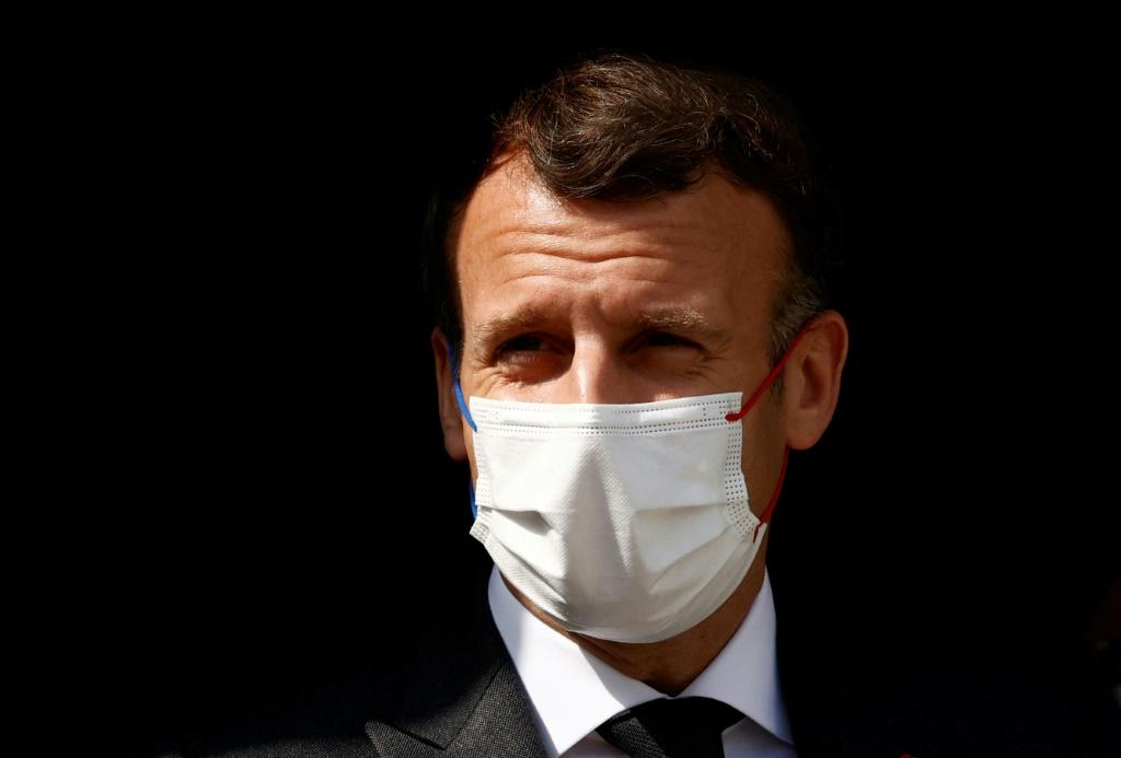 French President Emmanuel Macron, seen during a hospital visit in the city of Reims on April 14, 2021, has called for 'clear red lines' against unacceptable behavior by Moscow
