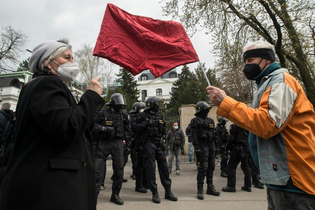 """Outside the Russian embassy in Peague protesters sported banners saying """"We're not Russia's backyard"""" and chanted """"Shame"""