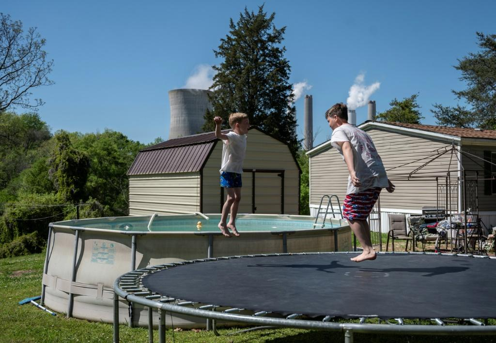 Children jump on a trampoline in Alabama near the Miller power plant, which has been ranked the top greenhouse gas-emitting plant in the United States