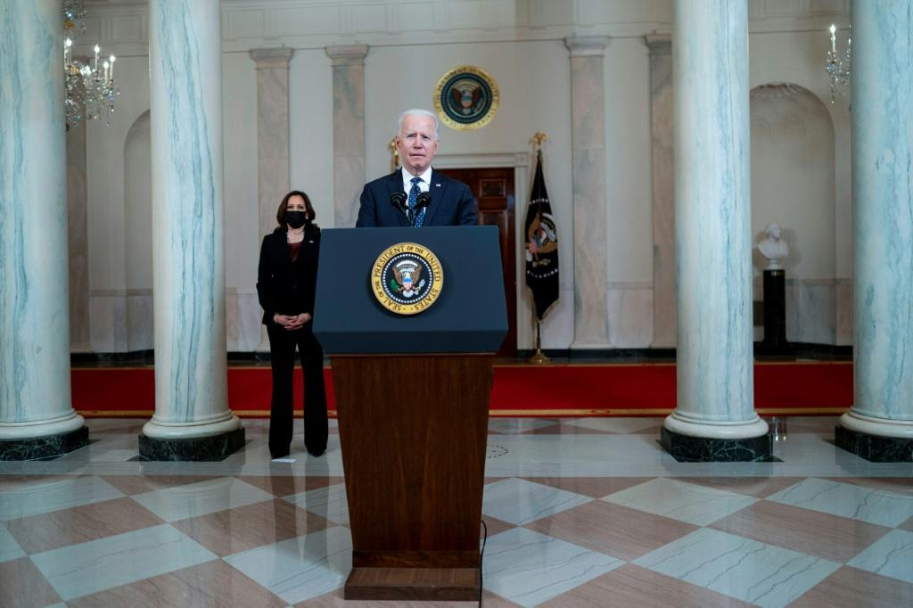 """US President Joe Biden calls systemic racism a """"stain on our nation's soul"""" as he delivers remarks at the White House on the murder conviction of former Minneapolis cop Derek Chauvin, as Vice President Kamala Harris looks on"""