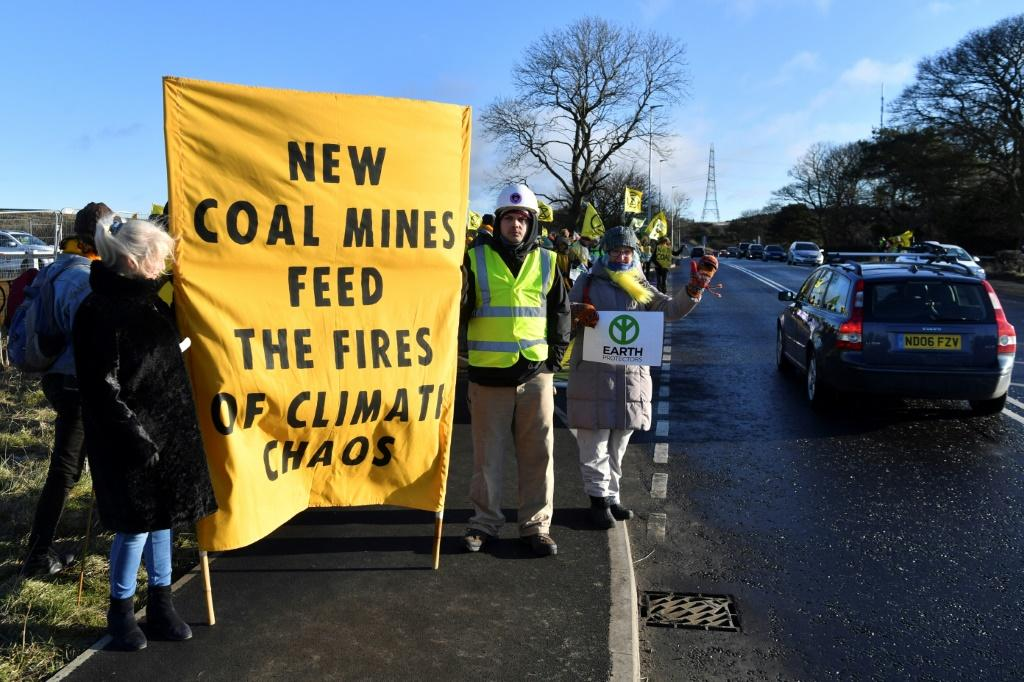 Activists from the Extinction Rebellion climate action group and local campaigners block the entrance to the site of the Bradley coal mine in the northeasern English county of Durham in February 2020