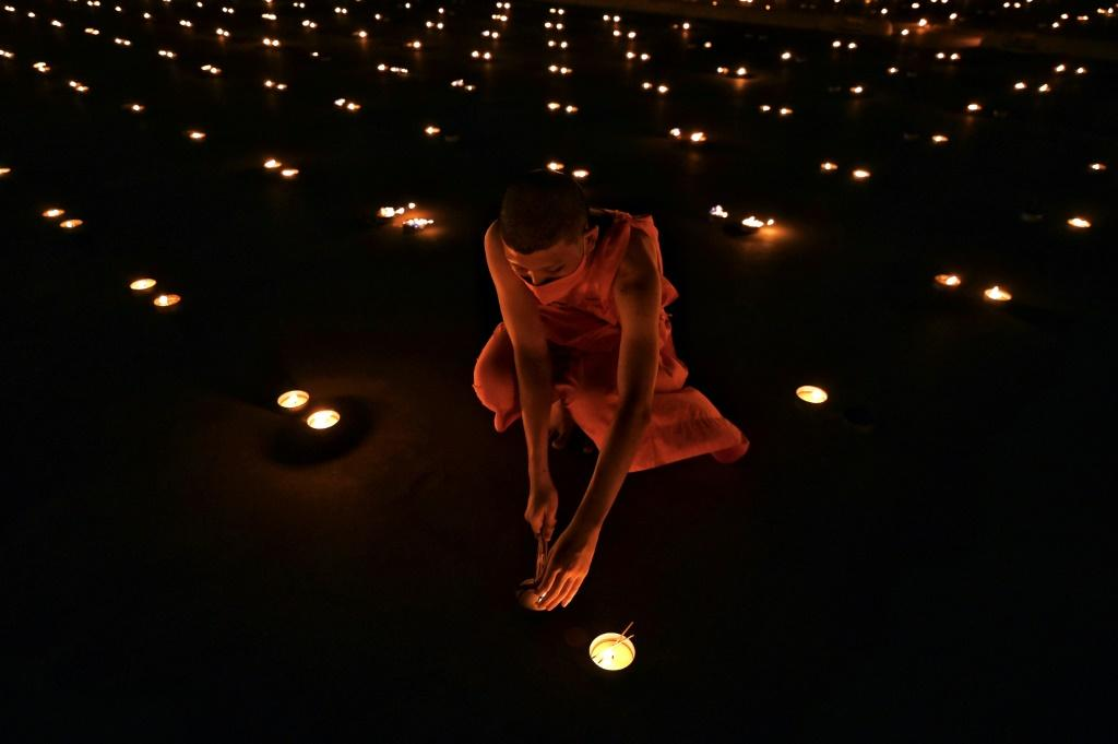 Monks chanted and 330,000 candles were burnt