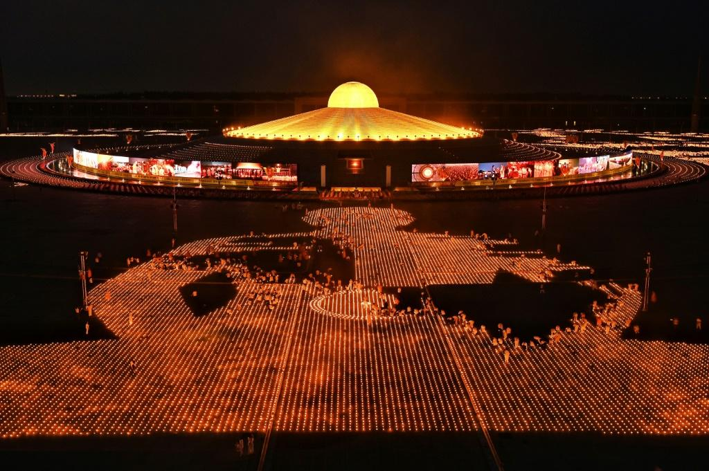 Thailand's Dhammakaya sect attempted to break a Guinness World Record for the largest flaming image to commemorate Earth Day