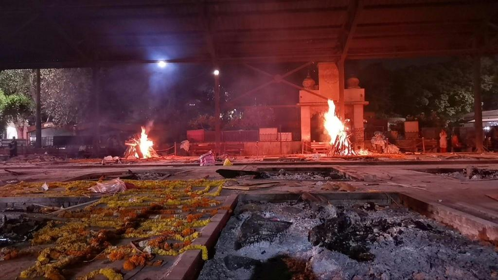 Crematoriums are working around the clock in many Indian cities, including New Delhi, to cope with the increasing Covid-19 fatalities, as grieving families wait for hours to cremate their deceased relatives.