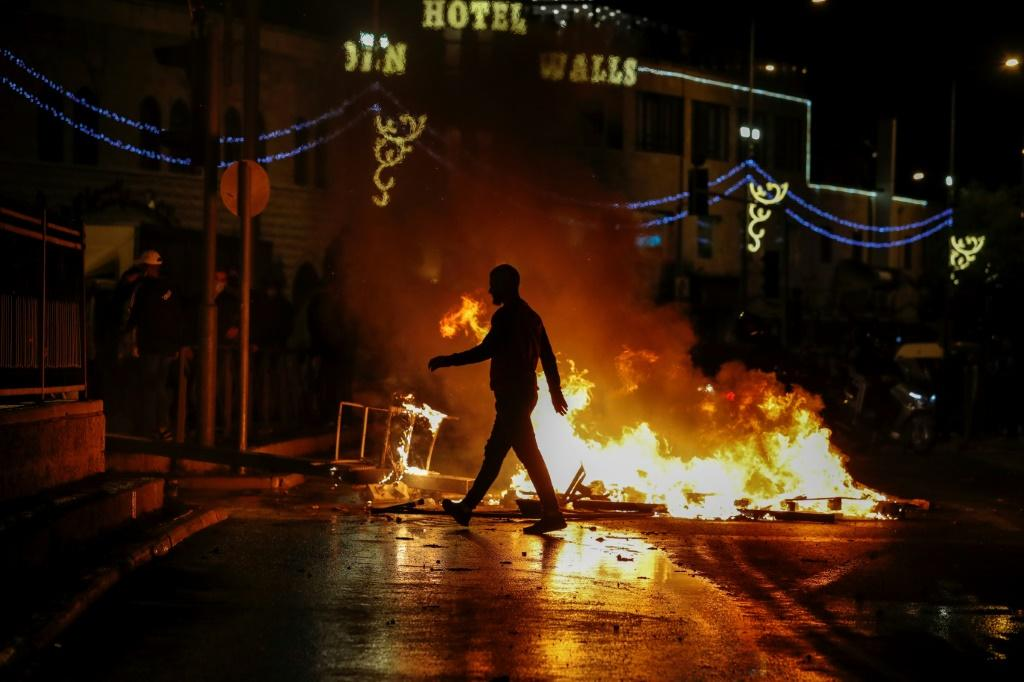 Palestinian protesters set rubbish ablaze on the streets of annexed east Jerusalem amid clashes with Israeli police in which more than 120 people are wounded