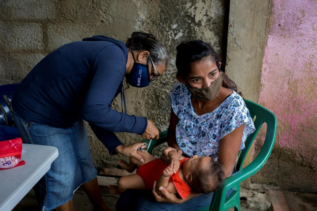 This child is getting a malaria vaccine in hopes that he will not join the hundreds of thousands of Venezuelans who contract the disease each year