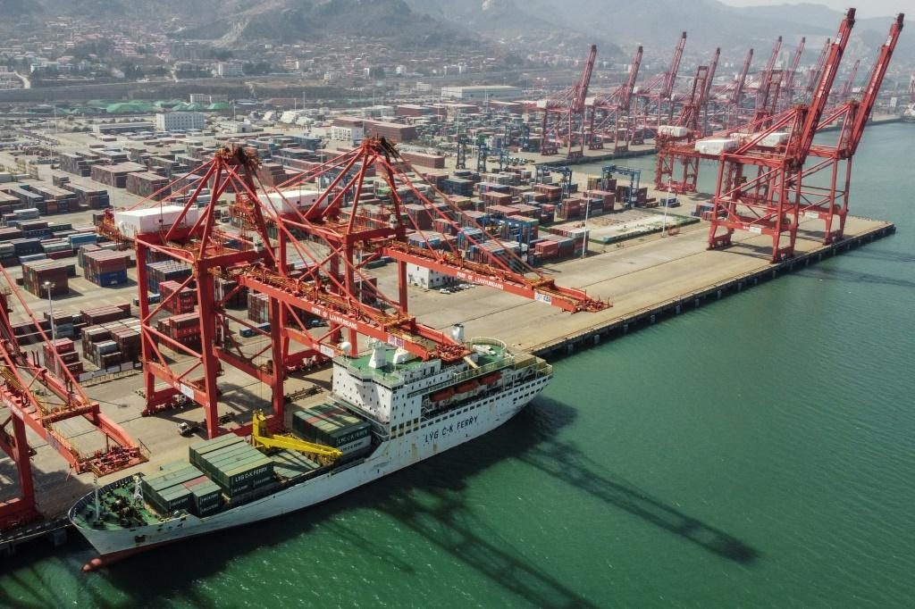 Growth in China's manufacturing activity slowed last month, with officials pointing to a global shortage of shipping containers among other problems