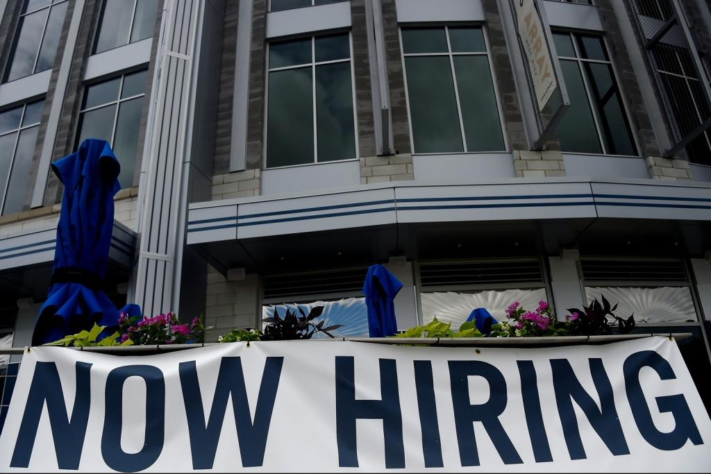 New filings for US unemployment aid dropped for the third straight week to a new pandemic low, indicating businesses may finally be recovering from the mass layoffs that began in March 2020