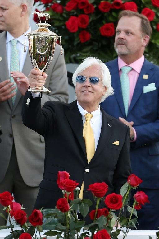 Trainer Bob Baffert hoists the Kentucky Derby trophy after Medina Spirit's victory in the 147th edition gave him a record seventh triumph in the Triple Crown race