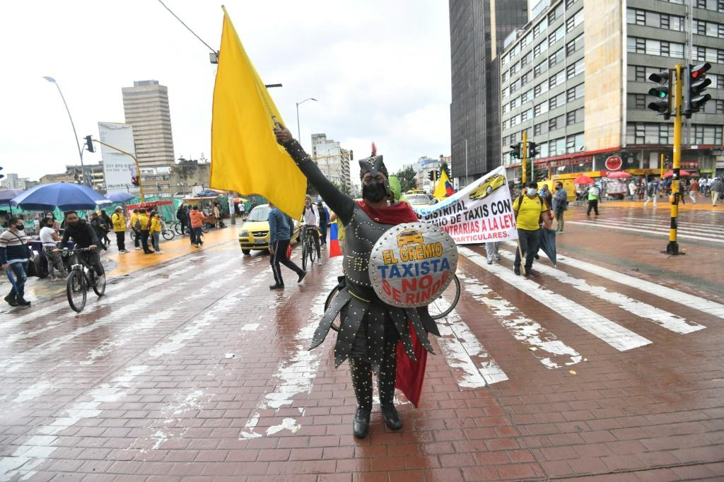 Taxi drivers protest against a tax reform bill launched by President Ivan Duque, in Bogota on May 3, 2021