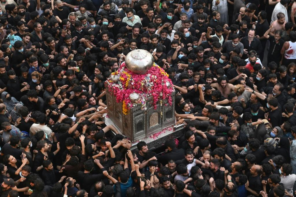 Despite coronavirus warnings, thousands of Shia Muslims –- many not wearing masks -- gathered in the eastern Pakistani city of Lahore for an annual religious procession