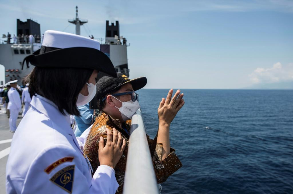 Naval officers pay their respects during a remembrance ceremony for the crew of the KRI Nanggala