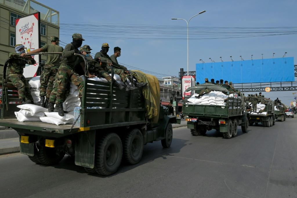 Soldiers have been transporting sacks of rice to people in red zones in Phnom Penh