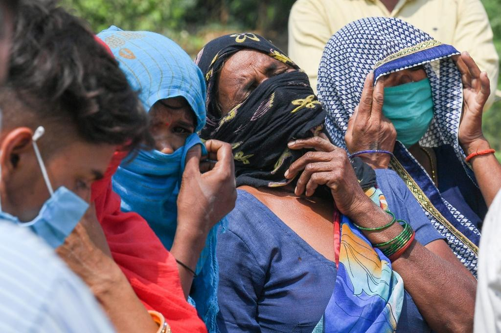 Relatives grieve as they arrive for the cremation of a loved one who died due to Covid-19, at a crematorium in Moradabad, India on May 5, 2021