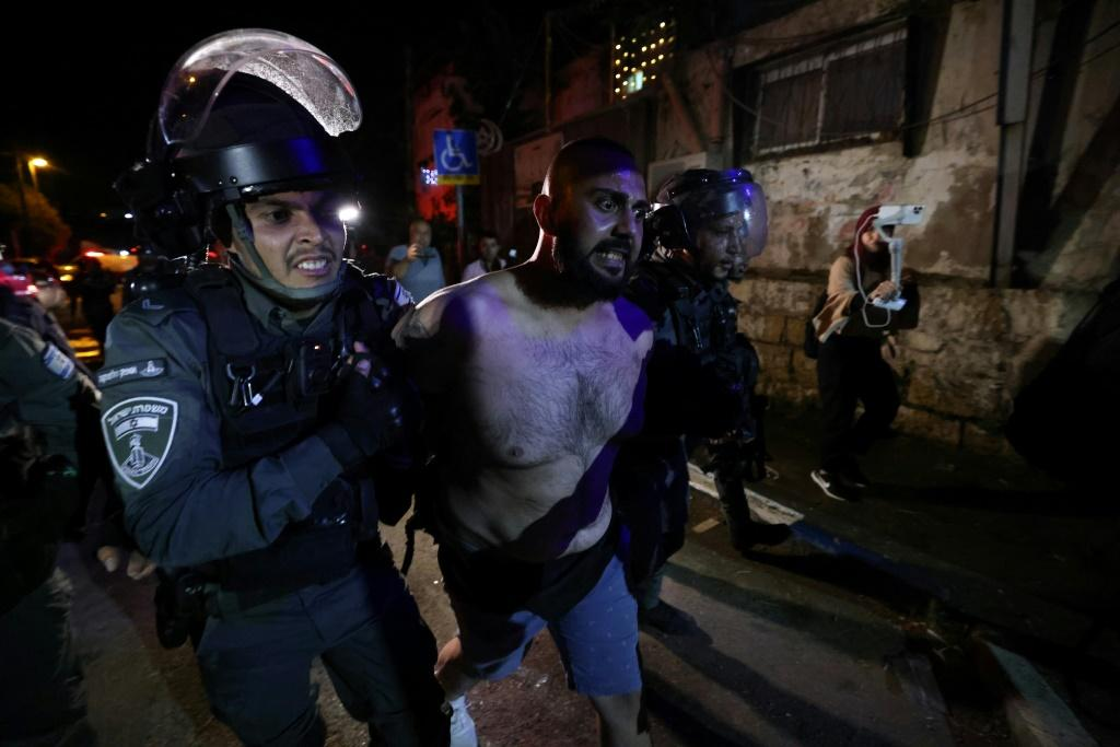 A Palestinian protester is arrested by Israeli police in the Sheikh Jarrah neighbourhood of annexed east Jerusalem, where land disputes with Jewish settlers have fuelled hostility for years