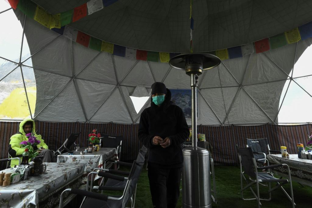 More than a thousand people are typically camped at the bustling tent city at the foot of Everest, including foreign climbers and the teams of Nepali guides that escort them to the peak