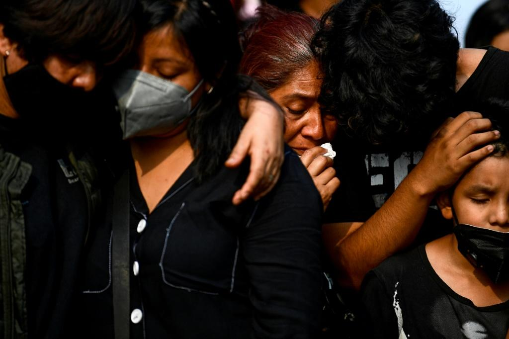 Relatives mourn Juan Luis Diaz, one of the 25 victims of Mexico City's metro disaster