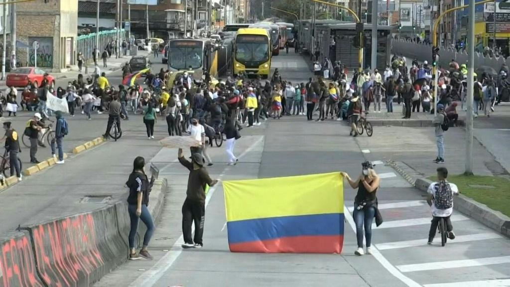 IMAGESProtesters block the Avenida Caracas, an arterial road of the Colombian capital Bogota. The country's government has invited protest leaders to a dialogue in an attempt to calm tensions following more than a week of demonstrations against President