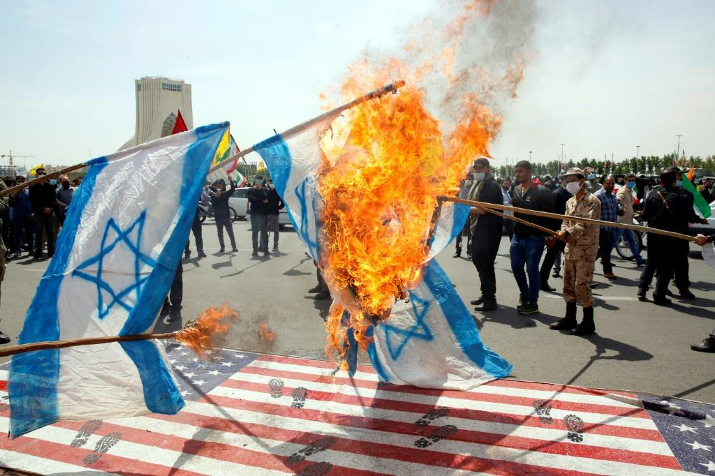 Iranians torch Israeli flags during a rally marking Al-Quds (Jerusalem) Day in Tehran