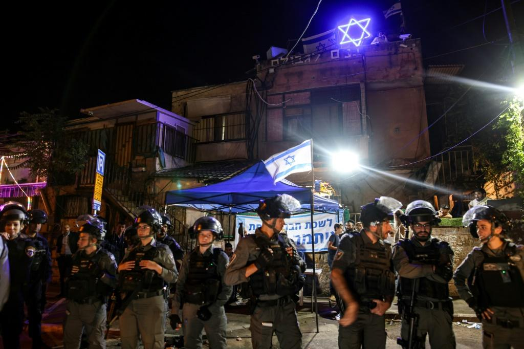 Israeli border police stand guard in front of a Sheikh Jarrah home occupied by Jewish settlers, outside which a far-right lawmaker has set up a makeshift parliamentary office