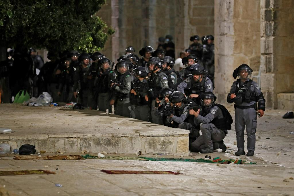 Israeli security forces deploy during clashes with Palestinian protesters at the al-Aqsa mosque compound in Jerusalem