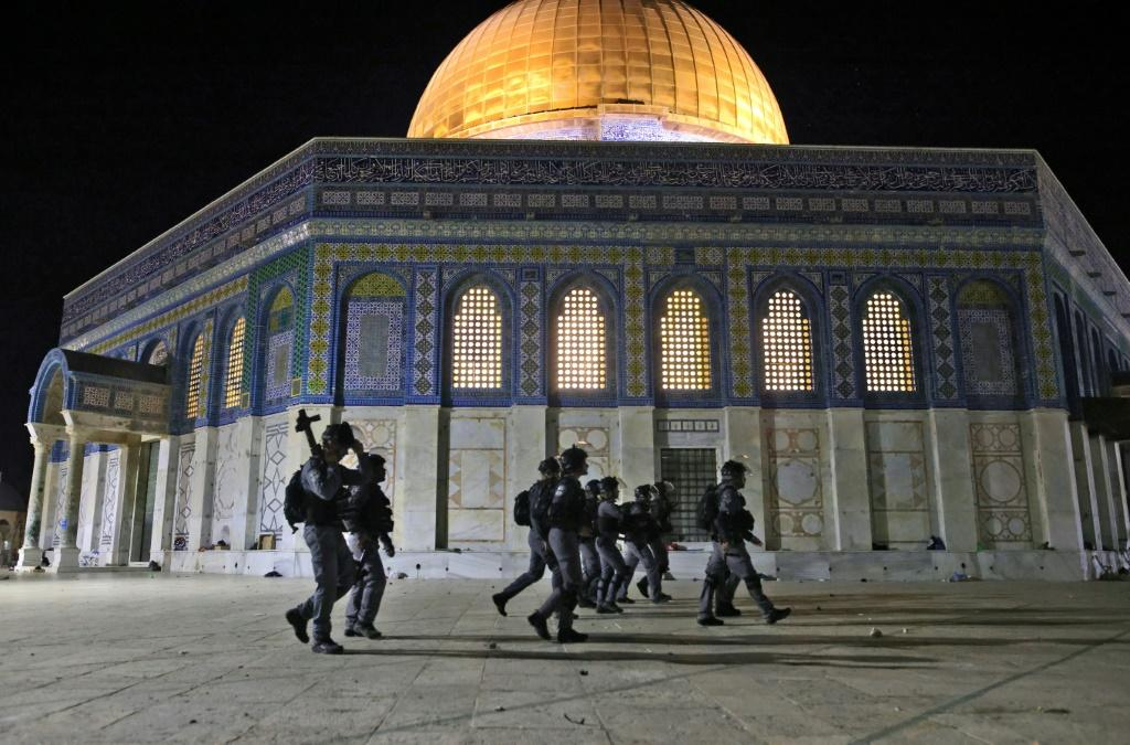 Israeli security forces deploy next to the Dome of the Rock mosque amid clashes with Palestinian protesters at the al-Aqsa mosque compound in Jerusalem