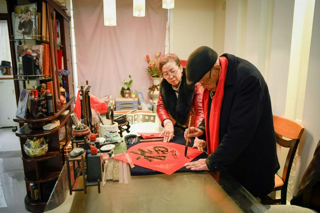 Calligraphy is one of the many hobbies practised by Gu Bin, who was already in his nineties when he taught himself to use the internet