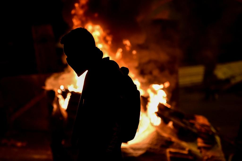 Protesters have put up barricades in Cali, setting some on fire, and have clashed with police