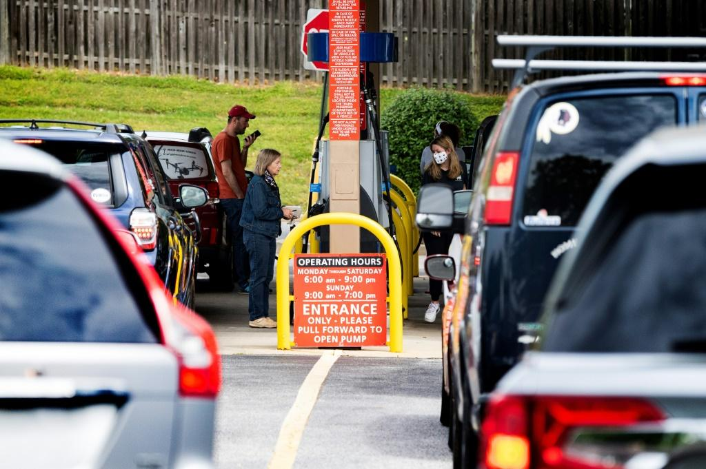 Stations with fuel in their tanks saw long lines of motorists rushing to fill up amid the Colonial Pipeline shutdown