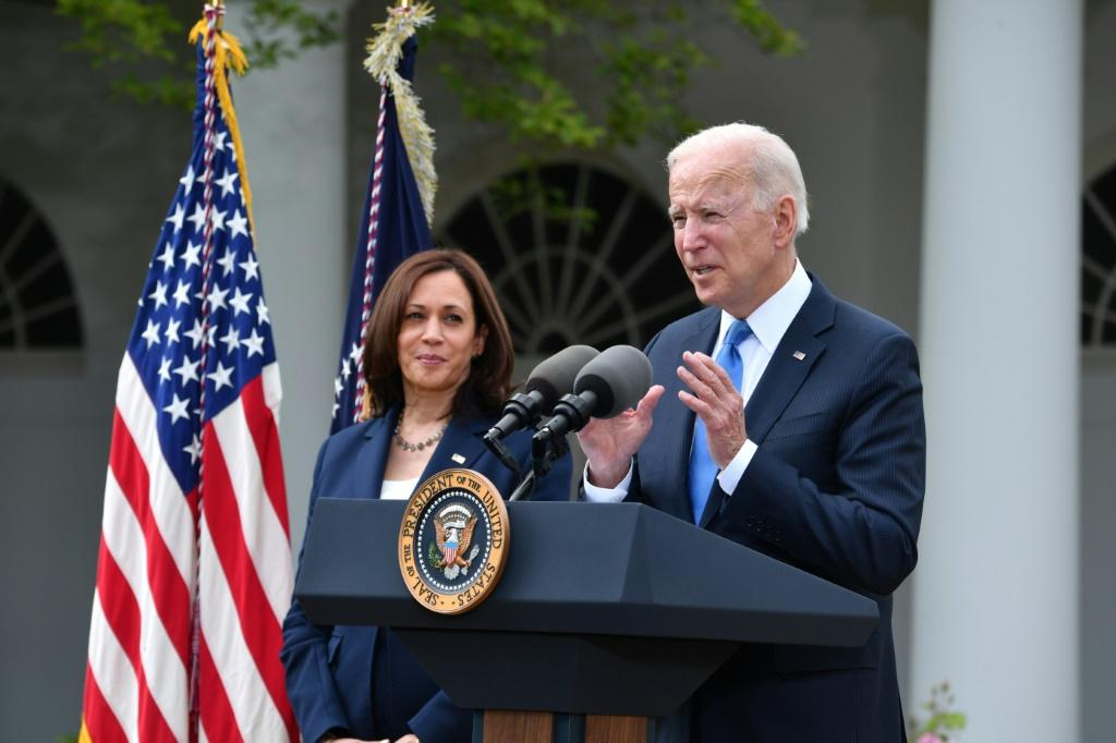 Joe Biden and Kamala Harris went mask-free after the Centers for Disease Control and Prevention said vaccinated people would no longer need to wear one, providing a psychological boost on the road to normality US Vice President Kamala Harris looks on as