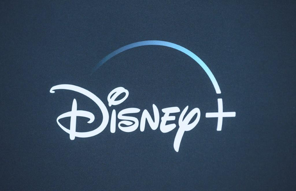 """The Disney+ logo is seen on the backdrop for the World Premiere of """"The Mandalorian"""" at El Capitan theatre in Hollywood on November 13, 2019"""