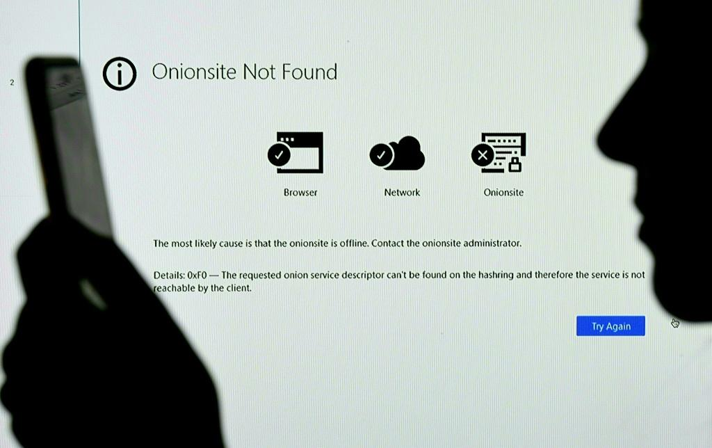 This photo illustration shows the Onionsite address for cyber-extortionist Darkside with a notice saying it could not be found
