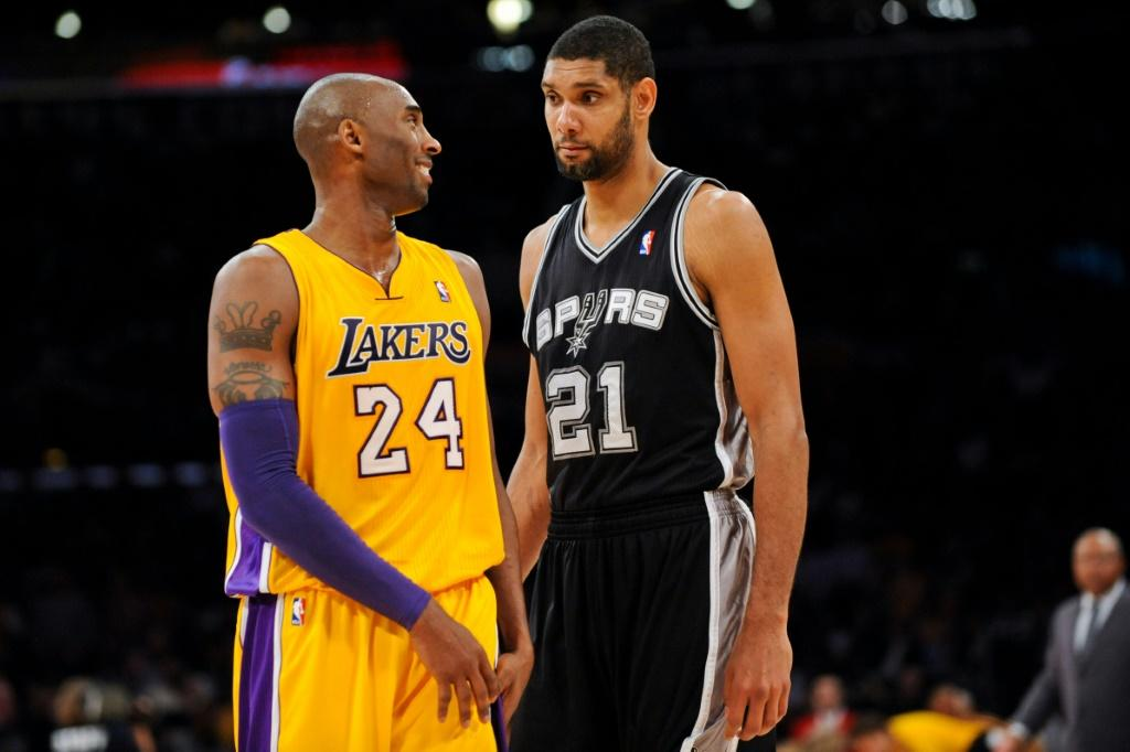 Tim Duncan of the San Antonio Spurs and Kobe Bryant of the Los Angeles Lakers share a laugh during a November 2012 NBA game. The two will be among those inducted as the class of 2020 -- Bryant posthumously after his death in a helicopter crash -- into the
