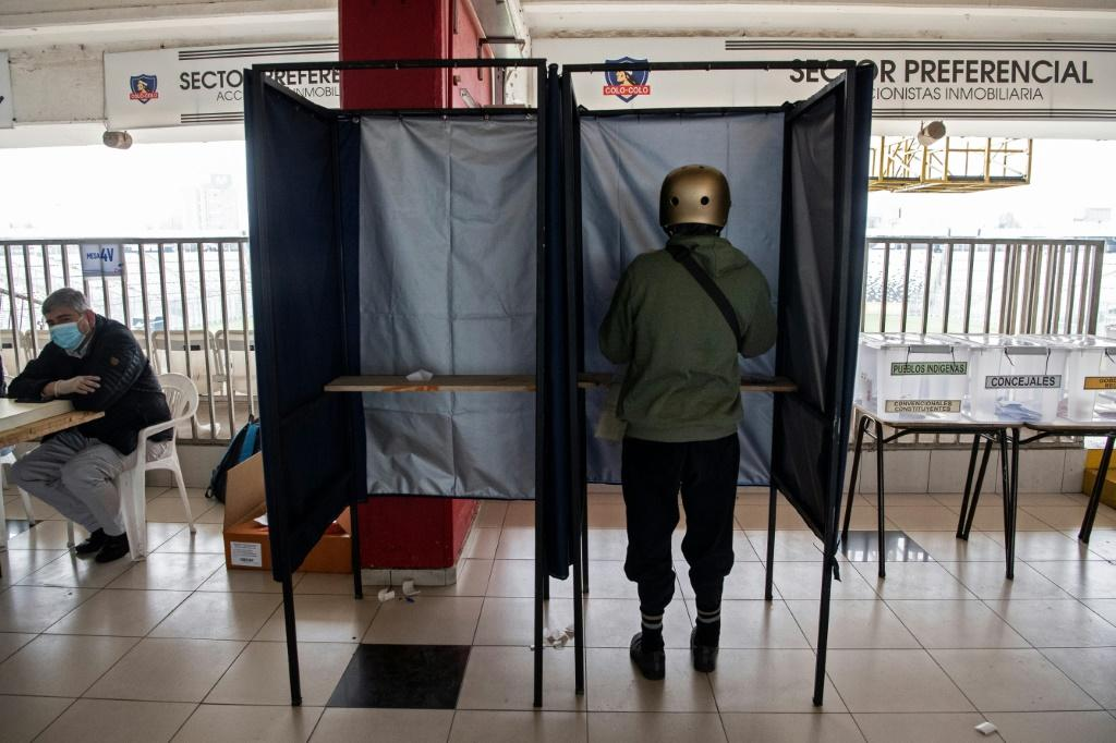 A person votes at a polling station in Santiago in Chile's elections on March 15, 2021