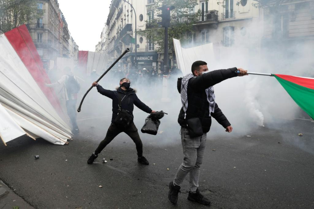 A protester throws a metal bar during a demonstration in Paris