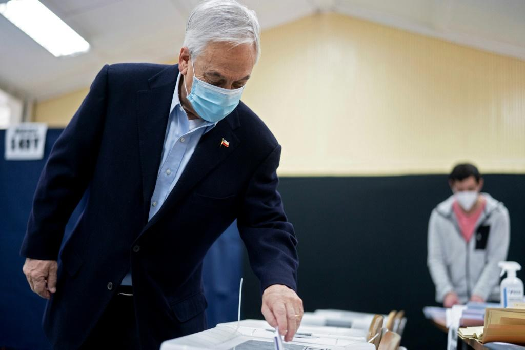 Chilean President Sebastian Pinera casts his vote in Santiago during elections to choose mayors, councillors and a commission to rewrite the constitution on March 15, 2021