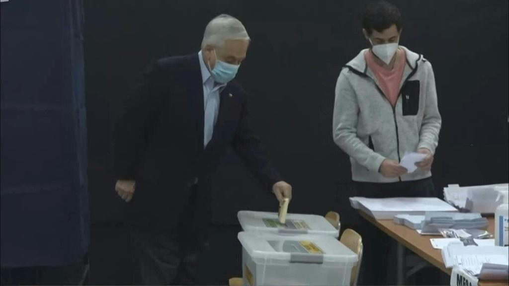 Chile's President Sebastian Pinera votes in an unprecedented election as the country is heading to the polls to decide who will write the new constitution