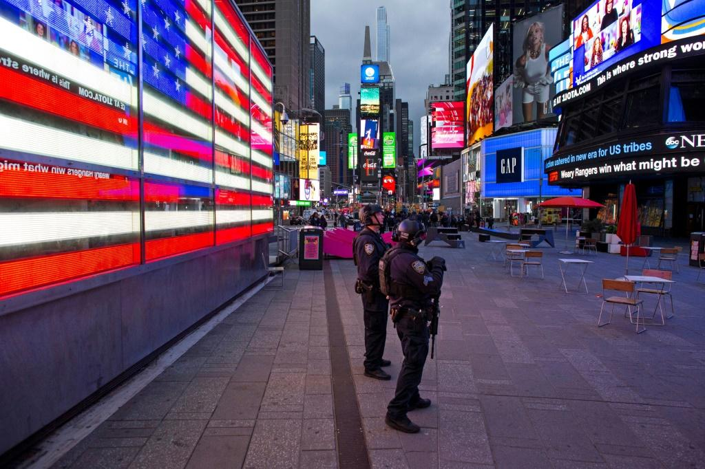 Police officers in Times Square after a shooting on May 8, 2021