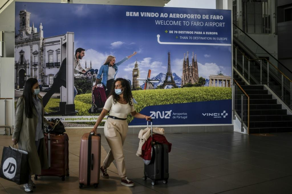 Passengers arrive at Faro airport in Algarve, southern Portugal