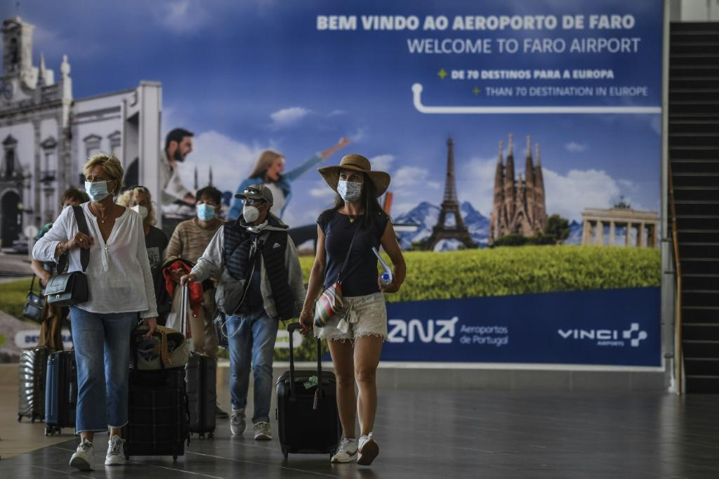 Tourists arrive at Faro airport in Portugal as the country eased restrictions