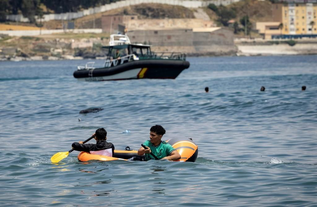 The migrants reached Ceuta by swimming or by walking at low tide from Moroccan beaches, some using rubber dinghies