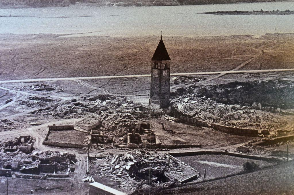 Curon's old city bell tower as it was before being submerged in the lake Resia in Italy