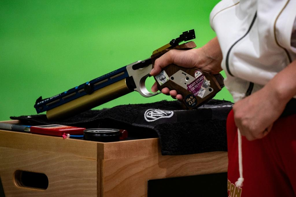 An athlete competes at a shooting test event for the Tokyo 2020 Olympics. Japan's tough gun-control laws are posing unusual problems at the Games, from the coach who can't touch a firearm to strict limits on ammunition