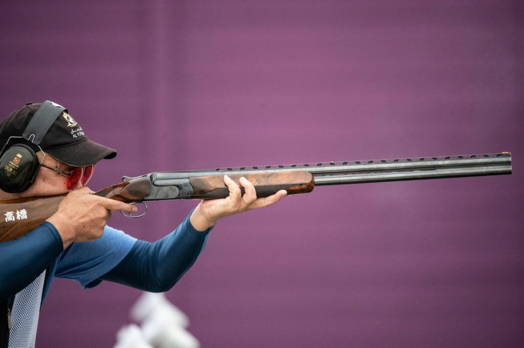 Kiyoshi Takanashi of Japan competes in the trap women and men final during a test event for the Tokyo 2020 Olympics last week. An athlete competes at a shooting test event for the Tokyo 2020 Olympics. Japan's strict gun laws are posing unusual problems at